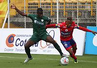 BOGOTA - COLOMBIA - 15 - 07 - 2017: Carmelo Valencia (Izq.) jugador de La Equidad disputa el balón con Yonni  Hinestroza (Der.) jugador de Deportivo Pasto, durante partido entre La Equidad y Deportivo Pasto,  por la fecha 2 de la Liga Aguila II-2017, jugado en el estadio Metropolitano de Techo de la ciudad de Bogota. /Carmelo Valencia (L) player of La Equidad vies for the ball with  Yonni  Hinestroza (R) player of Deportivo Pasto, during a match between La Equidad and Deportivo Pasto, for the  date 2nd of the Liga Aguila II-2017 at the Metropolitano de Techo Stadium in Bogota city, Photo: VizzorImage  /Felipe Caicedo / Staff.