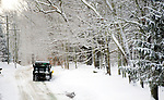 WINSTED, CT-122517JS10---A plow truck makes its way up Old North Road in Winsted clearing the roads after a fast moving snow storm dropped around three inches of snow throughout the northwest corner of the state on Monday. <br /> Jim Shannon Republican-American