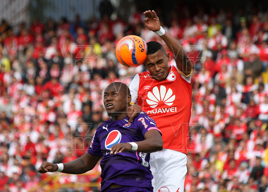 BOGOTA, COLOMBIA - January- 29-2017: William Tesillo (R) player of Independiente Santa Fe   fights for the ball with Cristian Nazarit (L) player of Independiente Medellin during a match between Independiente Santa Fe and Independiente Medellin as part of National Super League Aguila 2017 match played  at Nemesio  Camacho El Campin Stadium on January 29, 2016 in Bogota, Colombia.   Photo by Felipe Caicedo/ VizzorImage / Staff