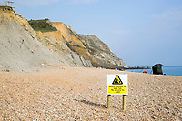 BNPS.co.uk (01202 558833)<br /> Pic: Graham Hunt/BNPS<br /> <br /> People ignoring safety advice to keep clear of the huge cliff fall at Seatown in Dorset.<br /> <br /> Warning sign on the beach informing visitors the beach is blocked and their is no access to Eype.
