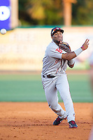 Greenville Drive second baseman Wendell Rijo (11) makes a throw to first base against the Charleston RiverDogs at Joseph P. Riley, Jr. Park on May 26, 2014 in Charleston, South Carolina.  The Drive defeated the RiverDogs 11-3.  (Brian Westerholt/Four Seam Images)