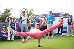Xing Aowei (pink pants) demonstrates his gymnast skills at the 1st hole during the World Celebrity Pro-Am 2016 Mission Hills China Golf Tournament on 23 October 2016, in Haikou, China. Photo by Weixiang Lim / Power Sport Images