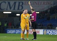 Tom Clarke(captain) of Preston North End confronts referee Graham Scott with team mate Aiden McGeady during the Sky Bet Championship match between Cardiff City and Preston North End at Cardiff City Stadium, Wales, UK. Tuesday 31 January 2017