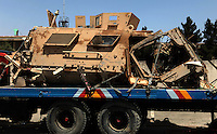 one of many MRAPs transported back to Kabul after being attacked by an IED in the field.