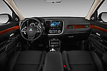 Stock photo of straight dashboard view of a 2015 Mitsubishi Outlander GT 4WD 5 Door SUV Dashboard