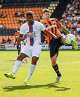 Michael Nelson of Barnet (right) clears the ball ahead of Fraizer Campbell of Crystal Palace (left) during the Friendly match between Barnet and Crystal Palace at The Hive, London, England on 11 July 2015. Photo by David Horn.