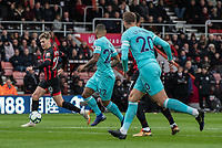 Bournemouth's David Brooks (left) under pressure from  Newcastle United's DeAndre Yedlin (centre)<br /> <br /> Photographer David Horton/CameraSport<br /> <br /> The Premier League - Bournemouth v Newcastle United - Saturday 16th March 2019 - Vitality Stadium - Bournemouth<br /> <br /> World Copyright © 2019 CameraSport. All rights reserved. 43 Linden Ave. Countesthorpe. Leicester. England. LE8 5PG - Tel: +44 (0) 116 277 4147 - admin@camerasport.com - www.camerasport.com