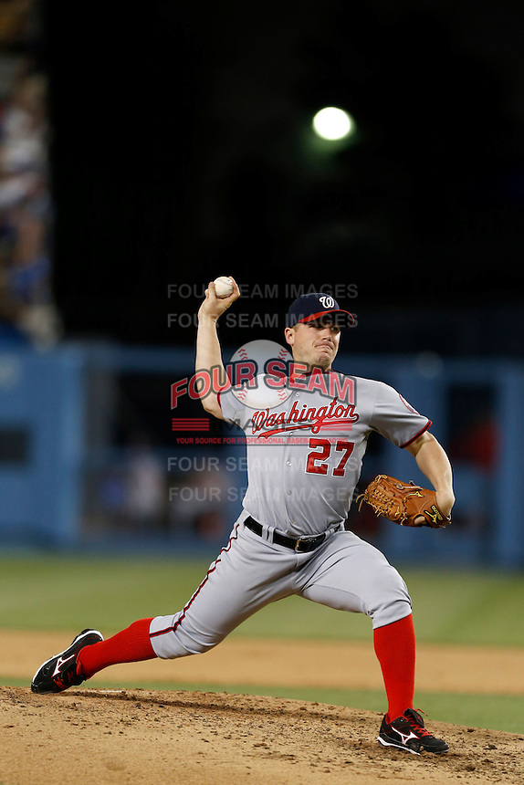 Jordan Zimmermann #27 of the Washington Nationals pitches against the Los Angeles Dodgers at Dodger Stadium on May 13, 2013 in Los Angeles, California. (Larry Goren/Four Seam Images)