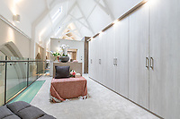 BNPS.co.uk (01202) 558833. <br /> Pic: LuxuryAndPrestige/BNPS<br /> <br /> Pictured: Dressing room. <br /> <br /> A heavenly converted chapel that has been transformed into a contemporary home is on the market for £1.5m.<br /> <br /> The Old Chapel was used by an order of nuns for 139 years before the humble church got a stylish upgrade into a four-bedroom property.<br /> <br /> The Grade II listed building has been carefully restored to retain stunning ecclesiastical features like windows, archways and doors, but with a modern twist.<br /> <br /> And although the owner bought it from the developer before it was finished, the stunning home has never been lived in.
