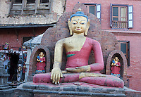 Kathmandu, Nepal.  Buddha Statue Showing the Gesture Symbolizing Enlightenment, Steadfastness, Imperturbability.  This is called the Bhumisparsa Mudra (Gesture), left hand in the lap, palm upward, right handover the right knee , fingers extended, slightly touching the ground.  This statue on the grounds of the Swayambhunath temple complex is called the Dhyani Buddha Aksobhya.