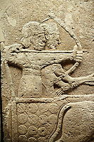 Picture & image of a Neo-Hittite orthostat with a chariot Releif sculpture from Karkamis,, Turkey.  The Chariot is pulled by horses with plumed headresses. One man os about to shoot an arrow from his bow, the other man is driving the cahriot. Below the horse is a animal cowering. An Ankara Museum of Anatolian Civilizations exhibit.