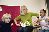 Janet, a specialist nursery nurse, uses Makaton signing whilst working with children in the I CAN project, which supports children with language difficulties.  Mulgrave Early Years Centre, Woolwich.