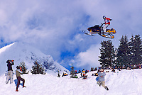 Man on Snowmobile jumping in Air at Competition Meet near Brohm Ridge, Garibaldi Provincial Park, Coast Mountains near Squamish, BC, British Columbia, Canada