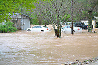 The home of Jeff and Debbie Ratliff on Rustic Drive was quickly inundated by rising water Wednesday morning. Water rescue teams from Bella Vista and Rogers Fire Departments rescued five people and two dogs from the residence and two more family members stranded in the water outside of the home.<br /> (Pea Ridge Times/Annette Beard)