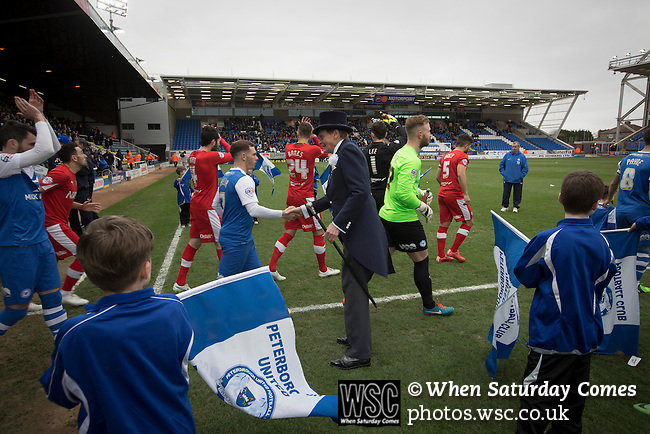 Peterborough United 1 Chesterfield 0, 21/03/2015. Abax Stadium, League One. Home club mascot known as Mr Posh greeting players as they walk onto the pitch at the Abax Stadium, before Peterborough United play Chesterfield in a SkyBet League One fixture. The home team won the match by one goal to nil, watched by a crowd of 6,612. The result allowed Peterborough to leapfrog their opponents into the League One play-off positions with eight games remaining of the season. Photo by Colin McPherson.