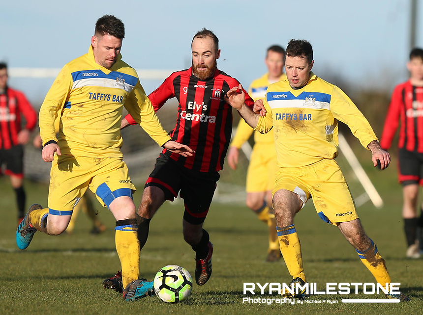 Derek Loughnane and Conor O' Brien of Thurles in action against Peake Villa's James O' Sullivan during the Munster Junior Cup 5th Round at Tower Grounds, Thurles, Co Tipperary on Sunday 11th February 2018, Photo By Michael P Ryan
