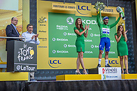 Fernando Gaviria (COL/Quick Step Floors) wins the sprint of the first stage and takes the Yellow Jersey, Green Jersey and White Jersey.  Here on podium to receive his green jersey flanked on podium with Eddy Merckx and Prince Albert of Monaco. <br /> <br /> Stage 1: Noirmoutier-en-l'Île > Fontenay-le-Comte (189km)<br /> <br /> Le Grand Départ 2018<br /> 105th Tour de France 2018<br /> ©kramon