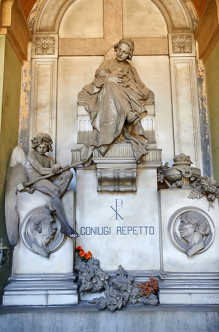 Picture and image of a stone sculpture of Charity with an angel to her left, by Sculptor V. Lavezzari 1897 on the Repetto tomb.  Section A, no 52, The monumental tombs of the Staglieno Monumental Cemetery, Genoa, Italy