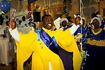"""Black British African church 1990s Uk. Celestial Church of Christ. Yoruba people harvest festival priests spiritual dancing celebration of faith This west African church was founded by S B J Oshoffa Mainly attended by Yoruba people from western Nigeria the church  flourishes with offshoots in London Paris and New York This  photograph is taken from the book The Storm is Passing Over"""""""