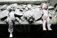"""""""I only went back once. I couldn't stop crying.""""<br /> -- Galina  Dondukova, former Pripyat kindergarten director<br /> <br /> Pripyat, Ukraine, was a closed Soviet city, population 49,360, built to house workers at the Chernobyl plant one mile away. In the days following the accident, families were evacuated and told they could return in 3 days. Some have never returned, yet still mourn their paradise lost. Valuables were stolen long ago, but abandoned dolls remain on a windowsill in the Solntsye kindergarten.  <br /> ------------------- <br /> This photograph is part of Michael Forster Rothbart's After Chernobyl documentary photography project.<br /> © Michael Forster Rothbart 2007-2010.<br /> www.afterchernobyl.com<br /> www.mfrphoto.com <br /> 607-267-4893 o 607-432-5984<br /> 5 Draper St, Oneonta, NY 13820<br /> 86 Three Mile Pond Rd, Vassalboro, ME 04989<br /> info@mfrphoto.com<br /> Photo by: Michael Forster Rothbart<br /> Date:  4/2007    File#:  Canon 20D digital camera frame 4996 <br /> ------------------- <br /> Original caption: .Photo title:.Kindergarten in Pripyat..Caption:.Pripyat, a closed Soviet city with population 49,360, was built to house workers at the Chernobyl Nuclear Power Plant one mile away. Today Pripyat is an eerie ghost town. Any valuables have long-since been stolen, but abandoned dolls remain on a windowsill here in the Solntsye kindergarten...These dolls and other abandoned toys and clothing have remained scattered here for 24 years, since the town was evacuated shortly after the April 26, 1986 Chernobyl accident. In the days following the accident, families were evacuated and told they could return in 3 days. Some have never returned, yet still mourn their paradise lost. ..Quote: . """"I only went back once. I couldn't stop crying."""".-- Galina  Dondukova, former Pripyat kindergarten director.-------------------"""