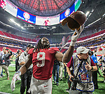Alabama running back Bo Scarborough tips the the leather trophy helmet to the fans after Alabama defeated Florida State 24-7 in the Chick-fil-A Kickoff game at the new Mercedes-Benz Stadium in Atlanta, Georgia on September 2, 2017.  Photo by Mark Wallheiser/UPI