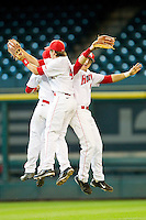 Cory Kay #4, Casey Grayson #43 and Landon Appling #1 celebrate after defeating the Arkansas Razorbacks at Minute Maid Park on March 3, 2012 in Houston, Texas.  The Cougars defeated the Razorbacks 4-1.  Brian Westerholt / Four Seam Images