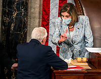 Speaker of the United States House of Representatives Nancy Pelosi (Democrat of California), right, speaks to US House Majority Leader Steny Hoyer (Democrat of Maryland), left, after a Republican member forced a vote on a resolution to exclude new members from those states that the President has disputed the election results in from getting sworn in on the opening day of the 117th Congress at the U.S. Capitol in Washington, DC on January 03, 2021. <br /> CAP/MPI/RS<br /> ©RS/MPI/Capital Pictures