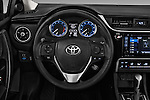 Car pictures of steering wheel view of a 2018 Toyota Corolla LE-Eco-AT 4 Door Sedan Steering Wheel