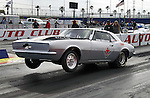 Drag Races! Silver Camero lifts off ground as race begins.