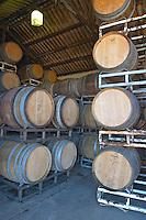 The barrel aging cellar with stacks of oak barriques. Bodega Pisano Winery, Progreso, Uruguay, South America