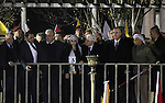 Palestinian President Mahmoud Abbas gestures during a rally marking the 50th anniversary of the founding of the Fatah movement, in the West Bank city of Ramallah December 31, 2014. Abbas signed on to 20 international agreements on Wednesday, including the Rome Statute of the International Criminal Court, a day after a bid for independence by 2017 failed at the United Nations Security Council. Photo by Shadi Hatem