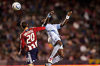 Sporting KC midfielder Kei Kamara (23) heads a ball past CD Chivas USA defender Zarek Valentin (20). Sporting KC defeated CD Chivas USA 3-2 at Home Depot Center stadium in Carson, California on Saturday March 19, 2011...