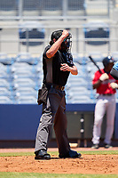 Umpire Chad Westlake calls a strike during a game between the FCL Twins and FCL Rays on July 20, 2021 at Charlotte Sports Park in Port Charlotte, Florida.  (Mike Janes/Four Seam Images)