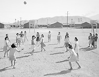 Japanese-American female internees playing volleyball at Manzanar War Relocation Center, Owens Valley, California, 1943.
