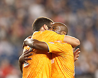 Second half substitute Houston Dynamo midfielder Luiz Camargo (17) celebrates tying goal with teammate. In a Major League Soccer (MLS) match, the New England Revolution tied Houston Dynamo, 2-2, at Gillette Stadium on May 19, 2012.