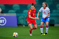 Angharad James of Wales Women's under pressure from Kara Djurhuus of Faroe Islands Women'sduring the UEFA Women's EURO 2022 Qualifier match between Wales Women and Faroe Islands Women at Rodney Parade in Newport, Wales, UK. Thursday 22 October 2020