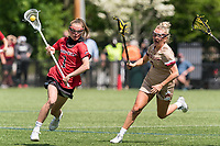 NEWTON, MA - MAY 14: Maggie Fort #1 of Fairfield University brings the ball forward during NCAA Division I Women's Lacrosse Tournament first round game between Fairfield University and Boston College at Newton Campus Lacrosse Field on May 14, 2021 in Newton, Massachusetts.