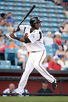 Nashville Sounds shortstop Hector Gomez (14) at bat during the first game of a double header against the Omaha Storm Chasers on May 21, 2014 at Herschel Greer Stadium in Nashville, Tennessee.  Nashville defeated Omaha 5-4.  (Mike Janes/Four Seam Images)