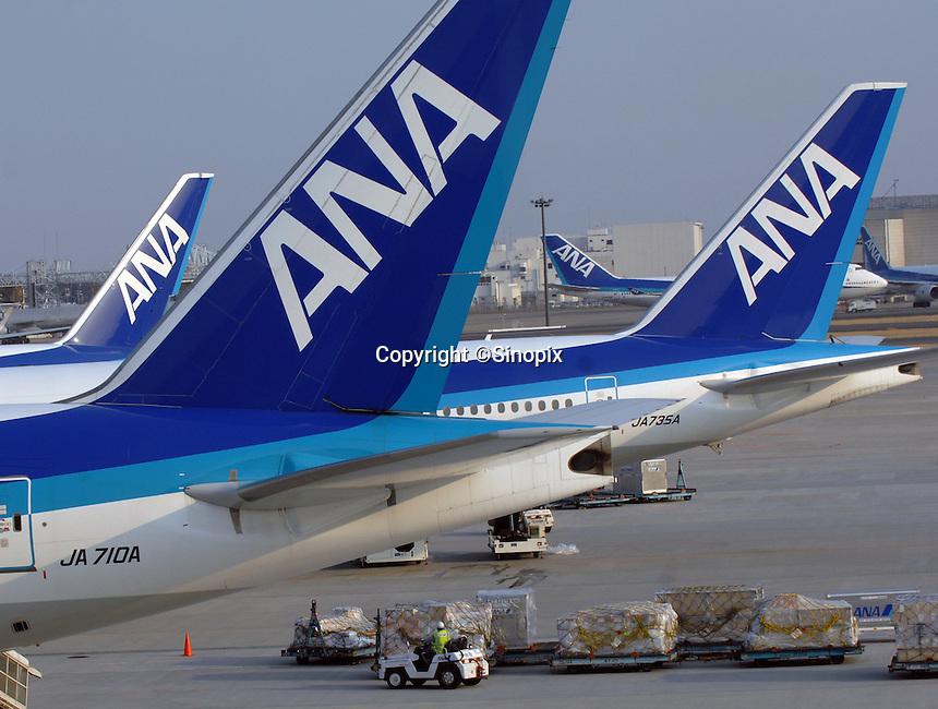 All Nippon Airways (ANA) planes wait on the tarmac of Narita International Airport, Tokyo, Japan.