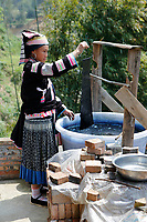 A woman of the ethnic Bouyei Tribe dyes a piece of muslin at home at Wangmo County in China's southwestern Guizhou Province, April 2019.