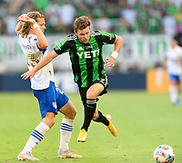 AUSTIN, TX - JUNE 19: Jon Gallagher #17 of Austin FC chases after a loose ball with Florian Jungwirth #23 of SJ Earthquakes defending during a game between San Jose Earthquakes and Austin FC at Q2 Stadium on June 19, 2021 in Austin, Texas.
