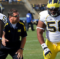 Michigan Wolverine head coach Brady Hoke instructs Ondre Pipkins. The Michigan Wolverines defeated the Purdue Boilermakers 44-13 on October 6, 2012 at Ross-Ade Stadium in West Lafayette, Indiana.