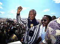 Nelson Mandela appears at an African National Congress (ANC) campaign rally the month before the first democratic elections in South Africa.  After more then 27 years in jail as an anti-apartheid activist,   Nelson Mandela lead a 1994 campaign for President as a member of the African National Congress (ANC),  in the first free elections in South Africa in 1994.  Mandela has received more than 250 awards over four decades, including the 1993 Nobel Peace Prize