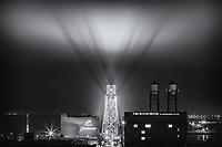 """The Signal""<br /> While Duluth slept, the bat signal pierced the fog over the Aerial Lift Bridge. On foggy nights, the lights on the Aerial Lift Bridge cast ethereal shadows skyward over Canal Park."