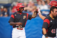 Batavia Muckdogs Cory Bird (right) high fives Isaiah White (18) after scoring a run during a game against the Staten Island Yankees on August 27, 2016 at Dwyer Stadium in Batavia, New York.  Staten Island defeated Batavia 13-10 in eleven innings. (Mike Janes/Four Seam Images)