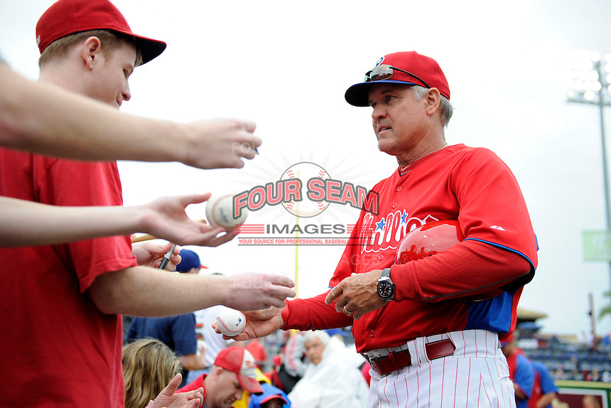 Philadelphia Phillies third base coach Ryne Sandberg #23 signs autographs before a Spring Training game against the New York Yankees at Bright House Field on February 26, 2013 in Clearwater, Florida.  Philadelphia defeated New York 4-3.  (Mike Janes/Four Seam Images)