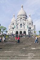 Tourists visit the basilique du Sacré-Coeur in Montmartre, Paris, France