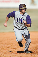 James Madison right fielder Kellen Kulbacki (21) heads towards third base versus Charlotte at Fieldcrest Cannon Stadium in Kannapolis, NC, Friday, March 2, 2007.  The Charlotte 49'ers defeated the James Madison Dukes 16-7.