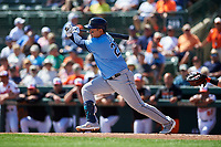 Tampa Bay Rays first baseman Ji-Man Choi (26) follows through on a swing during a Grapefruit League Spring Training game against the Baltimore Orioles on March 1, 2019 at Ed Smith Stadium in Sarasota, Florida.  Rays defeated the Orioles 10-5.  (Mike Janes/Four Seam Images)