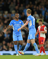 21st September 2021; Etihad Stadium,Manchester, England; EFL Cup Football Manchester City versus Wycombe Wanderers; Kevin De Bruyne of Manchester City celebrates his equalising goal after 29 minutes with team mate Raheem Sterling